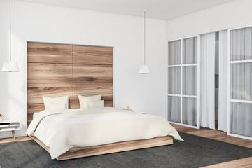 White and wood bedroom corner with door