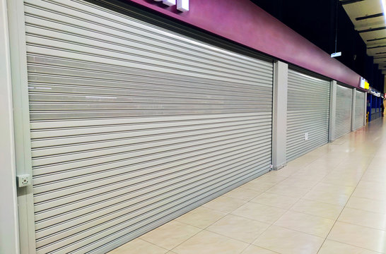 many closed boutiques in Mall during the global quarantine due to coronavirus pandemic. Recession and decline in sales in economy. Problems of small businesses and private sellers. closure of shops.