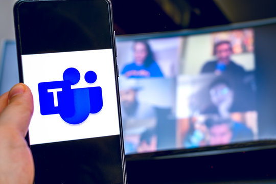 hand use videoconference app icon of Microsoft Teams on smartphone.
