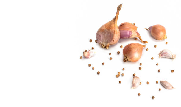 Group herbs consist of shallot ,garlic and coriander seeds isolated on white background.top view