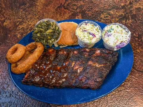 Barbecue platter on the table with meat and sides