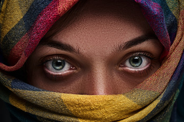Beggar orphan poor syrian woman refugee in a head scarf with sad eyes and tired look Fototapete
