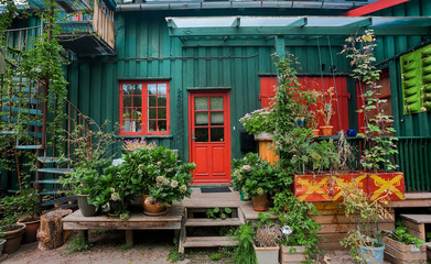 Small terrace with plants in wooden village house of Christiania Freetown, old hippie comunity