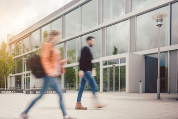 Blurred silhouette of students being busy on university campus