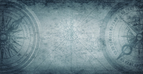 Wall Mural - Ancient old compass on the vintage map background. Adventure, discovery, navigation, geography, education, pirate and travel theme concept background. History and geography team. Retro stale.