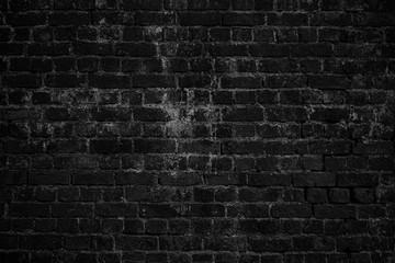 Black grunge brick urban wall.