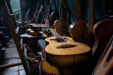 Acoustic Guitar Warehouse. Musical instruments. Production and training of playing the string. Wall mural