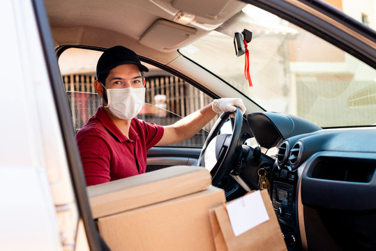 Latin male courier with orders in car. Food delivery service. Grocery delivery concept.