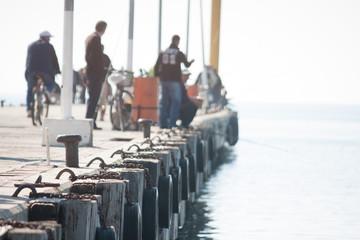 Group Of Fishermen On Pier