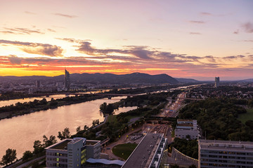 Dusk at the Danube River with the public recreation area called Danube Island and Kahlenberg