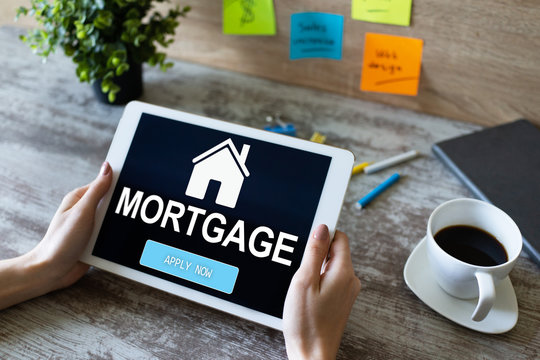 Mortgage online application form on device screen. Business and finance concept.