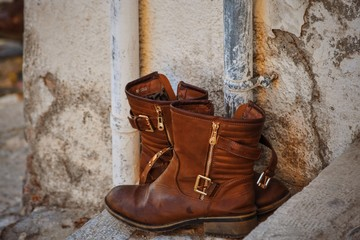 Close-up Of Brown Boots Against The Wall Wall mural
