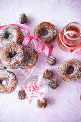 Sugar donuts on pink background