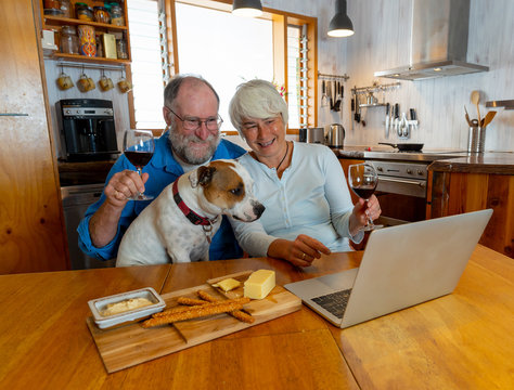 COVID-19 Stay safe, Stay Connected. Senior couple with pet dog video calling family and love ones