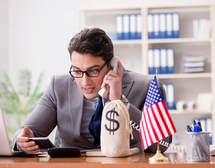 Businessman with American flag in office