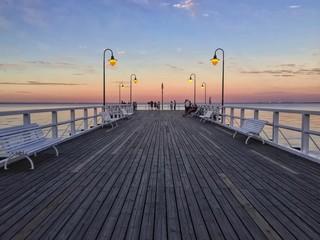 Fotobehang Meloen Pier On Sea At Sunset
