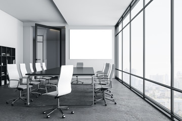 Modern meeting room with blank billboard on wall and city view.