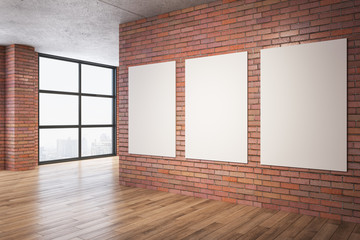 Clean red brick room with three blank banners on wall.