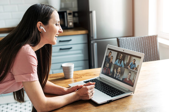 A girl is using zoom app for distance video communication with coworkers, friends. People profiles on laptop desktop. Online meeting, webinars