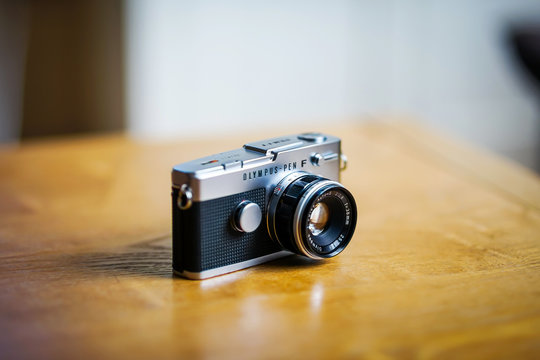 London, England UK. May 4th 2020: A vintage Olympus Pen FT camera and 38mm F1.8 Zuiko lens. A small SLR 35mm half-frame film camera from 1966-1972. Built-in meter, made in Japan. Copy text space.