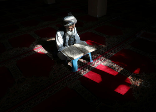 An Afghan man reads the Koran at a mosque during the holy month of Ramadan in Kabul, Afghanistan