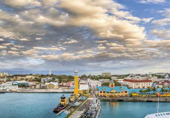 Wall Mural - Nassau, Bahamas. Beautiful city view at sunset from cruise ship bridge