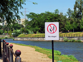 Dog walking prohibition sign on the river banks