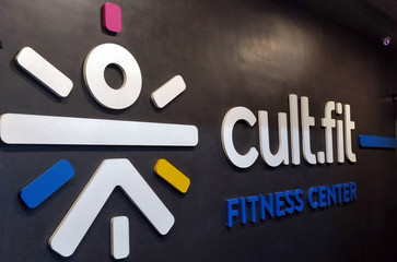 The logo of cult.fit, a wellness unit of Indian gym and wellness startup cure.fit, is seen at one of its fitness centres, in Bengaluru