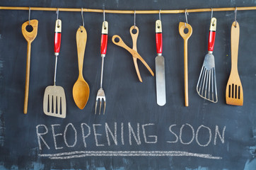 Restaurant display,announcing reopening after the corona lockdown,cooking, culinary concept on blackboard.
