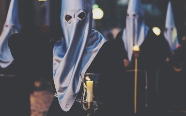 People Holding Lit Candle During Good Friday