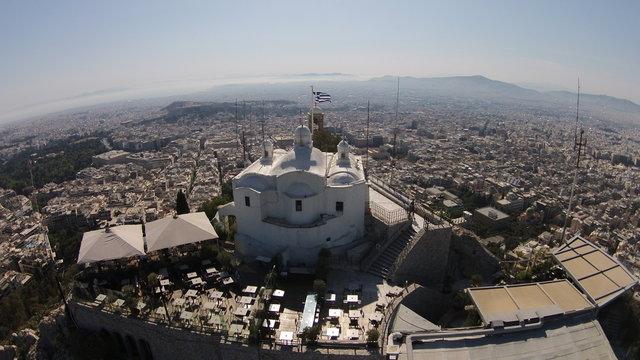 Church Of Agios Georgios On Mount Lycabettus By Residential District Against Sky