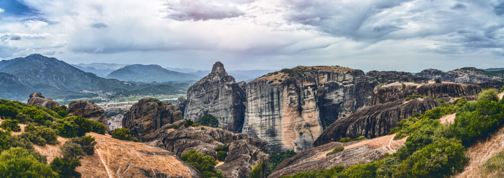 huge rock formation in the mountainous landscape of meteora, greece