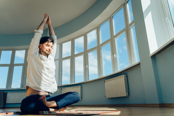 Man practice yoga. Young attractive male doing breathing exercises. Guy meditating at home along during the pandemic. Relaxation and resting concept for isolation. Slide shot.