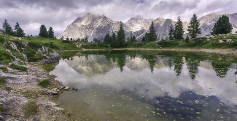 Fotomurales - Wonderful Dolomites Alps during sunset. Lago di Limides, Italy. Tofana di Rozes mountain ridge. Region Trentino Alto Adige, South Tyrol, Veneto, Dolomite Alps, famous travel destination in Europe