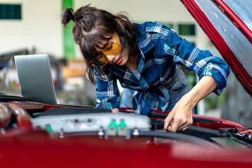 Asian young female car repair worker.
