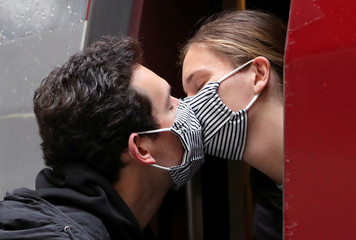 A couple kisses on a Thalys high-speed train after spending 2 months in Brussels