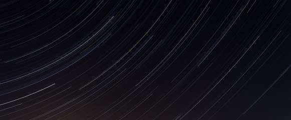 Star tracks on a dark background.