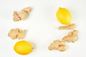 two fresh lemons and five pieces of ginger