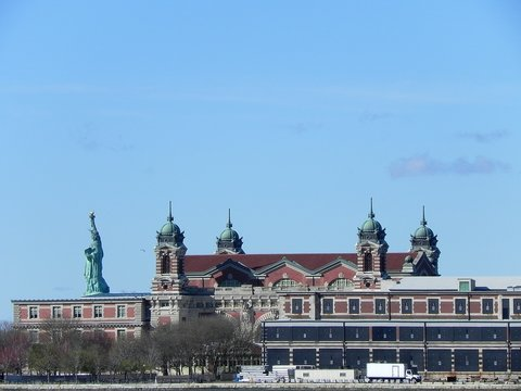 Statue Of Liberty And Ellis Island Against Blue Sky