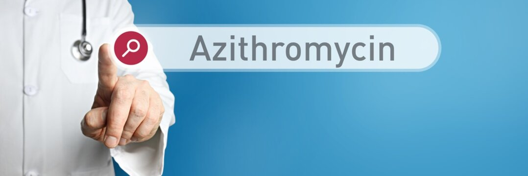 Azithromycin. Doctor in smock points with his finger to a search box. The term Azithromycin is in focus. Symbol for illness, health, medicine