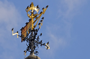 Closeup of St Edward's Crown atop the Royal Standard weather vane and birds, White Tower, The Tower of London, London, England