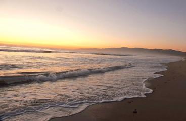 Keuken foto achterwand Grijs Scenic View Of Beach Against Sky During Sunset