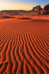 Dramatic ripples of sand in the sunrise at Wadi Rum desert, Jordan, with a clear sky and no people