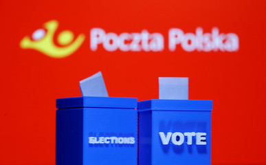 A 3D printed ballot boxes are seen in front of displayed Poczta Polska logo in this illustration
