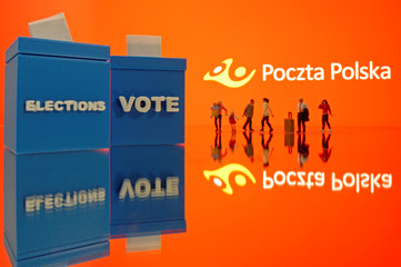 A 3D printed ballot boxes and toy people figures are seen in front of displayed Poczta Polska logo in this illustration