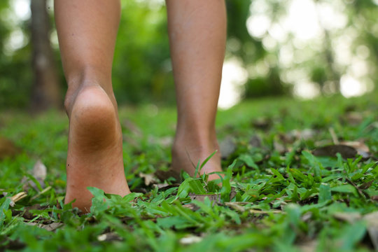 Heels of children walking on the grass