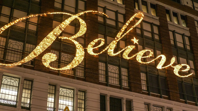 believe writing on the house facade of famous macys department store in manhattan - new york / usa - december 4, 2018