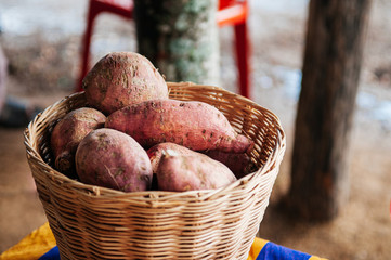 Sweet potatoes or yam in wooden basket, asian farming product