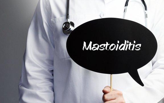 Mastoiditis. Doctor in smock holds up speech bubble. The term Mastoiditis is in the sign. Symbol of illness, health, medicine