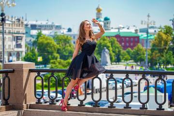Wall Mural - Young beautiful woman in fashion black dress